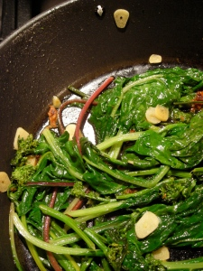 sauted garlic scapes with leafy veg